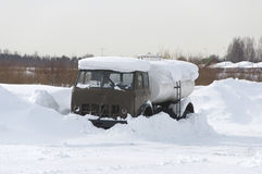 Tank truck under snow Royalty Free Stock Photography