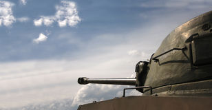Tank turret and gun. Side view of military tank turret and gun with cloudscape background and copy space royalty free stock photos