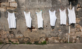 Tank Undershirts Drying in the Sun Royalty Free Stock Image