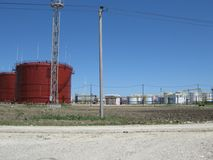 Tank the vertical steel. Capacities for storage of oil  products Royalty Free Stock Photography