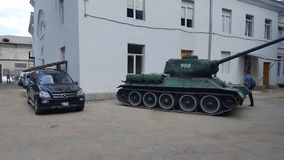 Tank vs Mercedes Royalty Free Stock Image