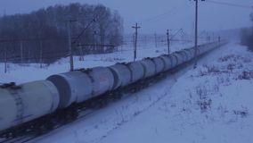 Tank Wagons in movement in winter. Tank wagons train passing. Trans-Siberian Railway. Full HD Resolution 1920×1080 Video Frame Rate 29.97 Length 0:28 stock video