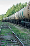 Tank wagons with oil. Freight train in forest royalty free stock images