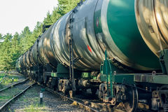 Tank wagons with oil. Freight train in forest Royalty Free Stock Photo