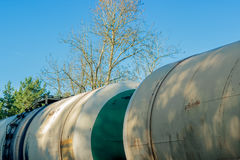 Tank wagons with oil. Freight train in forest stock image