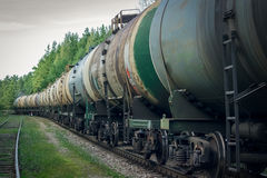 Tank wagons with oil. Freight train in forest Stock Images