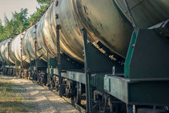 Tank wagons with oil. Freight train in forest royalty free stock photos