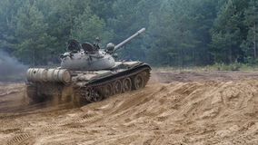 TANK WARSAW PACT. Old military vehicle on the off-road royalty free stock photography