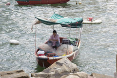 Tanka Fisherwoman mending nets Royalty Free Stock Photography
