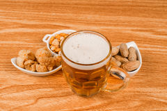 Tankard of beer and snacks Royalty Free Stock Images