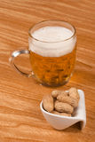 Lager and peanuts Royalty Free Stock Images