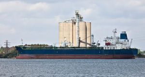 Tanker. Oil tanker among oil storage tanks in Houston Texas Stock Photo