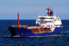 Tanker A. Coastal Tanker underway at sea over blue sky and sea Royalty Free Stock Photography