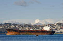 Tanker. A huge tanker ship in a bay, seaside city and Elliott bay in the background Stock Photos