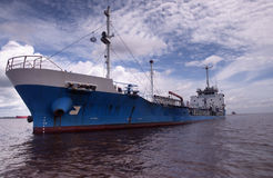 Tanker anchorage. Blue oil tanker anchorage at indonesia port stock photography