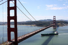Tanker below the Golden Gate Bridge. Tanker (boat) going under the Golden Gate Bridge in San Francisco, California, USA, on a clear day Royalty Free Stock Photos