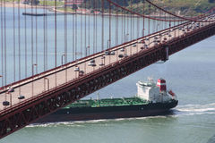 Tanker below the Golden Gate Bridge. Tanker (boat) going under the Golden Gate Bridge in San Francisco, California, USA, on a clear day Stock Photo