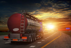 Tanker with chrome tanker on the highway. Stock Photos