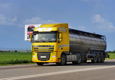 Tanker with chrome tanker on the highway. Working visit Royalty Free Stock Photo