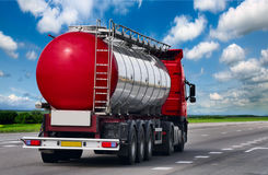 Tanker with chrome tanker on a large paved road Stock Images