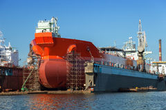 Tanker in dry dock. A large tanker repairs in dry dock. Shipyard Gdansk, Poland Stock Image