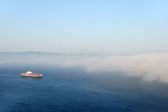 Tanker Entering Fog. A tanker carrying containers flowing into the fog Royalty Free Stock Images