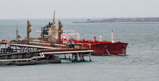 Tanker in front of an oil storage terminal. Waiting for loading in Tsemesskaya (Novorossiyskaya) bay. Novorossiysk, Russia Stock Image