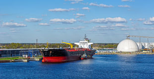 Tanker in front of an oil storage terminal Stock Image