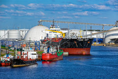 Tanker in front of an oil storage terminal Stock Images