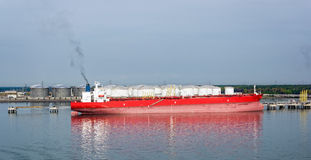 Tanker in front of an oil storage terminal Royalty Free Stock Images