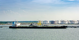 Tanker in front of an oil storage terminal Stock Photo