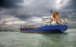 Tanker goes into port. Under. stormy sky Royalty Free Stock Image