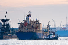 Tanker in harbor with tug Royalty Free Stock Image