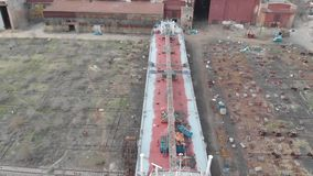 Tanker lifted out of the water to repair and paint the hull stock footage