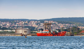 Tanker loading. Red cargo ship moored in Varna port Royalty Free Stock Image