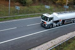Tanker lorry on the road. White Tanker lorry in motion on the road royalty free stock photography
