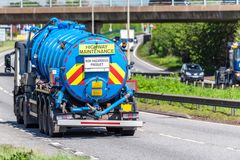 Tanker lorry truck on uk motorway in fast motion.  royalty free stock image
