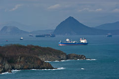 Tanker moving across the bay past the headland. Nakhodka Bay. East (Japan) Sea. 05.05.2014 Stock Photo