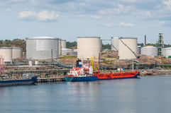 Tanker with oil storage. Tanker unloading with oil storage tanks in the background Stock Image