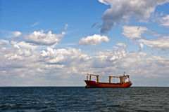 Tanker in the open sea. Big tanker in the open sea\ocean under the blue cloudy sky Royalty Free Stock Photos