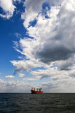 Tanker in the open sea. Big tanker in the open sea\ocean under the blue cloudy sky Royalty Free Stock Photo