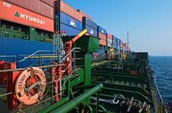 Tanker Ostrov Russkiy raid bunker on the container ship Hyundai companies.. Nakhodka Bay. East (Japan) Sea. 19.04.2014 Stock Photos