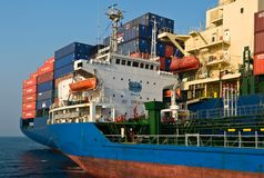 Tanker Ostrov Russkiy raid bunker on the container ship Hyundai companies.. Nakhodka Bay. East (Japan) Sea. 19.04.2014 Stock Photo