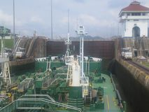 Tanker in the Panama canal. Oil tanker in a lock off the Panama canal. The mules can be seen holding the bow in place Stock Image