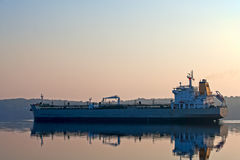 Tanker on Penobscot River in Maine. A large tanker going up the Penobscot River, Maine in the early morning light Royalty Free Stock Image