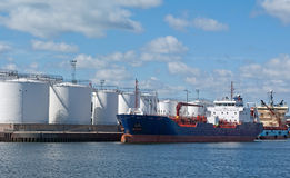 Tanker by quayside storeage tanks Stock Image