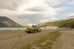 A tanker rolling along the alaska highway Royalty Free Stock Image