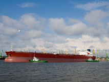 Tanker ship. A long oil tanker docking at the harbor Stock Photo