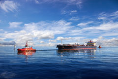 Tanker ship. Being guided into port by two tugs Royalty Free Stock Image