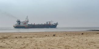 Tanker ship at coastline Stock Photography